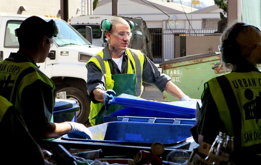 Former gang member Eliseo Nunez works at his job at the Urban Corps recycling center.