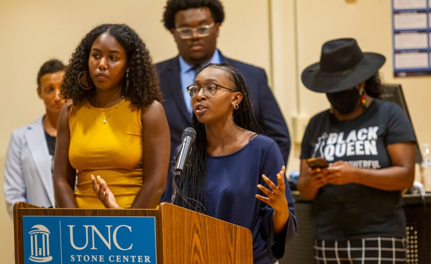 """Taliajah """"Teddy"""" Vann, president of the campus Black Student Movement, speaks during a press conference hosted by the Black Student Movement, the Carolina Black Caucus and the Black Graduate and Professional Student Association Wednesday, July 7, 2021, at UNC Chapel Hill's Sonja Haynes Center in Chapel Hill, N.C. Student leaders and activists discussed Nikole Hannah-Jones's decision to turn down UNC-Chapel Hill's offer as Knight Chair for Race and Investigative Journalism with tenure as well safety concerns for Black students and a list of demands for the future of UNC's Black Community. (Travis Long/The News & Observer via AP)"""