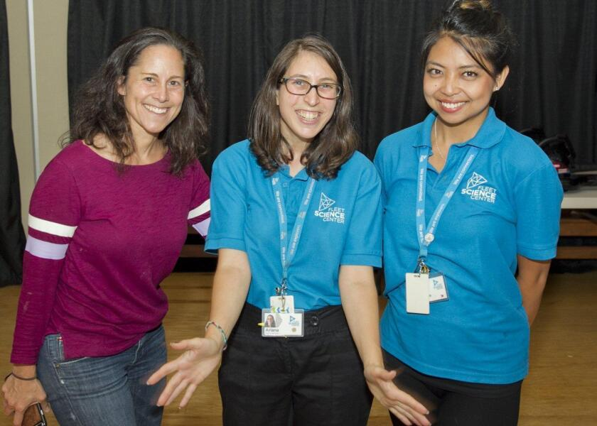 PTA coordinator Stephanie Bernstein with Ariana Walker and Alessandra Monzon from the Fleet Science Center