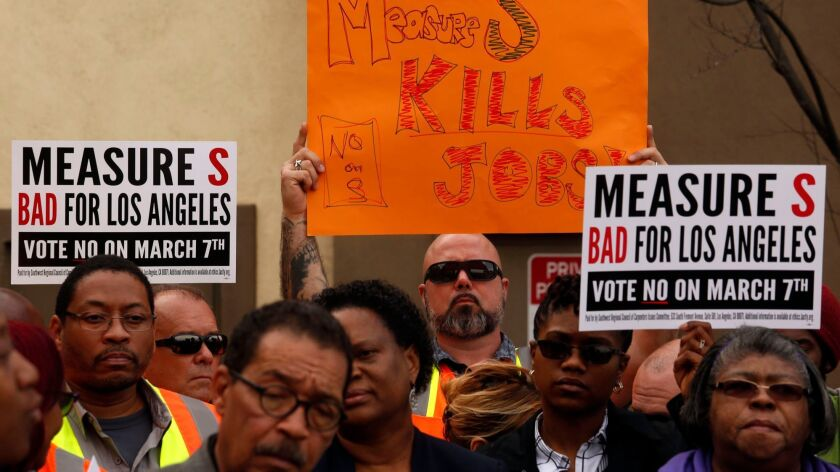 """Workers with the Southwest Regional Council of Carpenters and members of SEIU joined Los Angeles City Councilmen Herb Wesson and Marqueece Harris-Dawson at a """"Say No to Measure S"""" news conference at the West Angeles Community Development Corporation in South Los Angeles."""