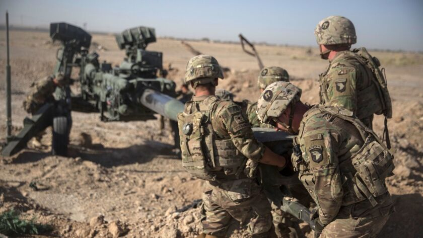 American soldiers maneuver an M-777 howitzer at Bost Airfield in Afghanistan on June 10, 2017.