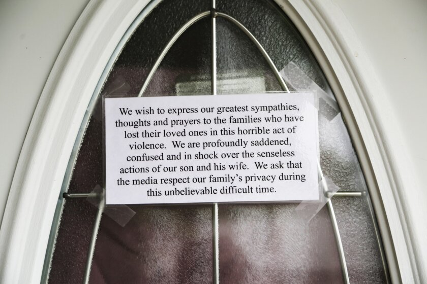 A note expressing profound sadness while at the same time asking for privacy from the media is posted on the front door of the home of Jerad Miller's parents on Tuesday, June 10, 2014, in Lafayette, Ind. Miller and his wife, Amanda, on Sunday shot and killed two Las Vegas police officers and a person at a Wal-Mart. As police closed in at the store, Amanda Miller shot her husband several times with a handgun, killing him. She then shot herself in the head. When officers arrived, she was still breathing, and was taken to the hospital. She later died. (AP Photo/Journal & Courier, John Terhune) NO SALES
