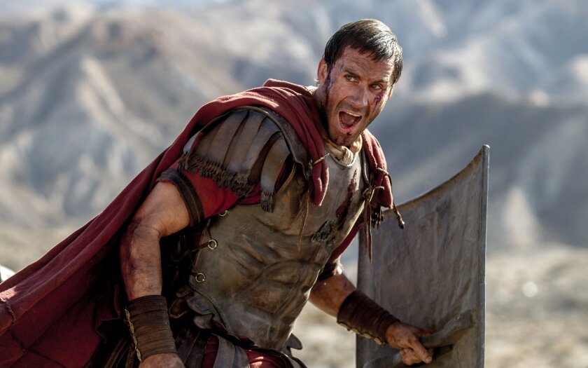 "In this image provided by Columbia Pictures, Joseph Fiennes as Clavius leads his Roman soldiers during the zealot battle in Columbia Pictures' ""Risen."" The movie opens in U.S. theaters nationwide Feb. 19, 2016. (Rosie Collins/Columbia Pictures via AP)"