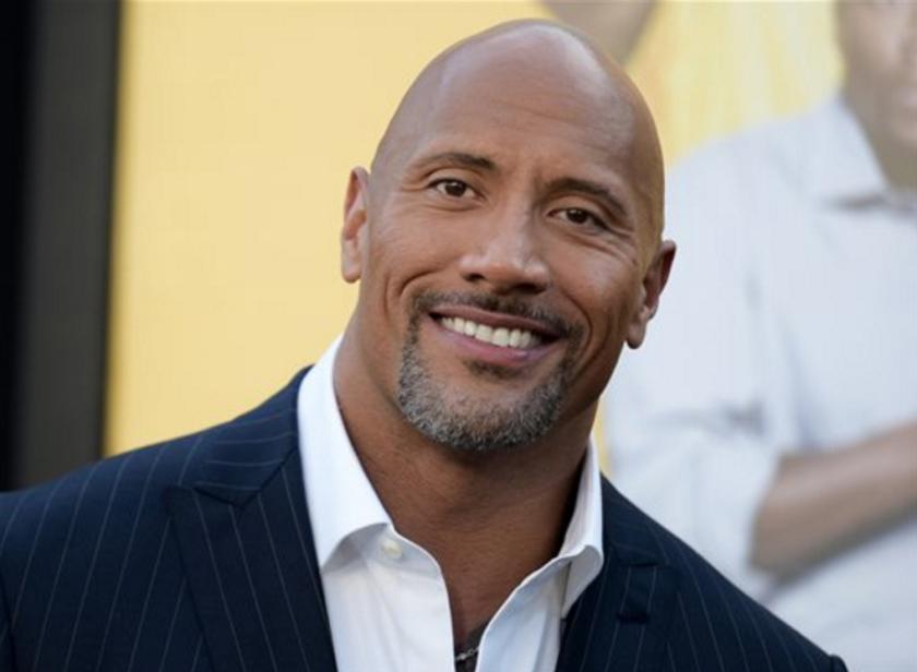 """Dwayne Johnson llega al estreno de la cinta """"Central Intelligence"""" en Los Angeles. Johnson es el actor mejor pagado, según la revista Forbes, con ingresos de 64,5 millones de dólares. (Foto por Richard Shotwell/Invision/AP, Archivo)"""