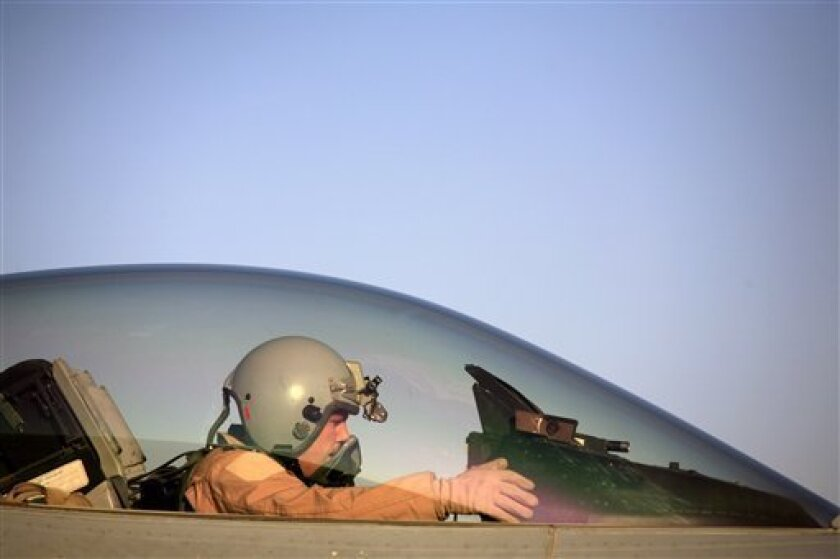 In this June 21, 2007 file photo, U.S. Air Force Capt. Shaun Germain prepares to pilot his F-16 Falcon aircraft at Balad Air Base, 50 miles north of Baghdad, Iraq. Jordanian officials said June 5, 2013 that the U.S. will deploy anti-missile batteries and F-16 jet fighters in the kingdom to bolster