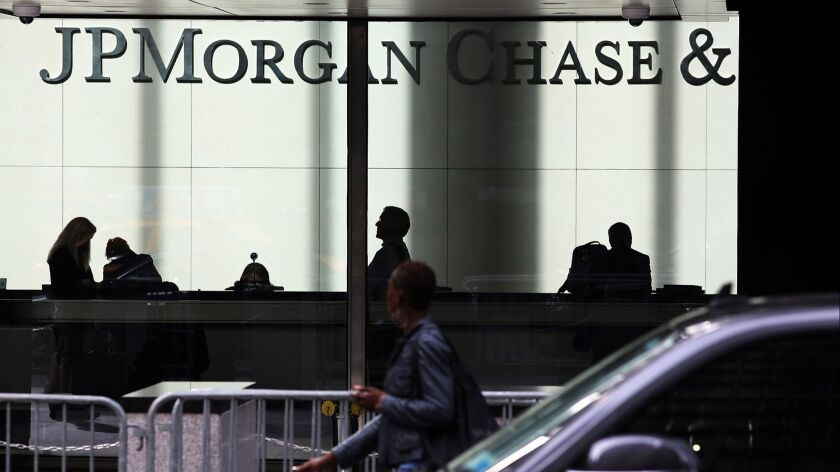 FILE: Chase's Dimon To Retain Dual Role