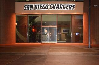 San Diego Chargers fans clean up egged headquarters