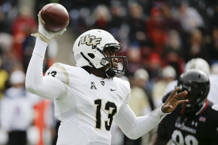 UCF quarterback Justin Holman throws in the first half of an NCAA college football game against Cincinnati, Saturday, Oct. 31, 2015, in Cincinnati. (AP Photo/John Minchillo)