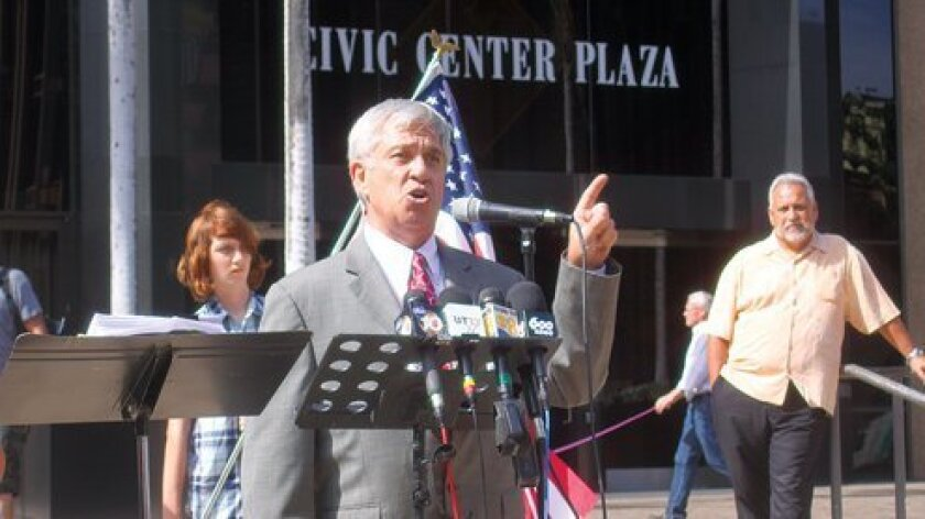Michael Pallamary addresses a crowd of about 100 people on July 19 at city hall, stating his reasons for wanting to recall San Diego Mayor Bob Filner. Photo by Ashley Mackin