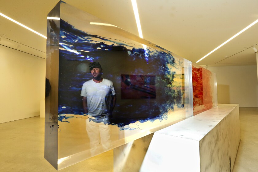 LOS ANGELES, CA-APRIL 27, 2017: Artist Sterling Ruby is reflected in his piece titled, ACTS/SURVIVA
