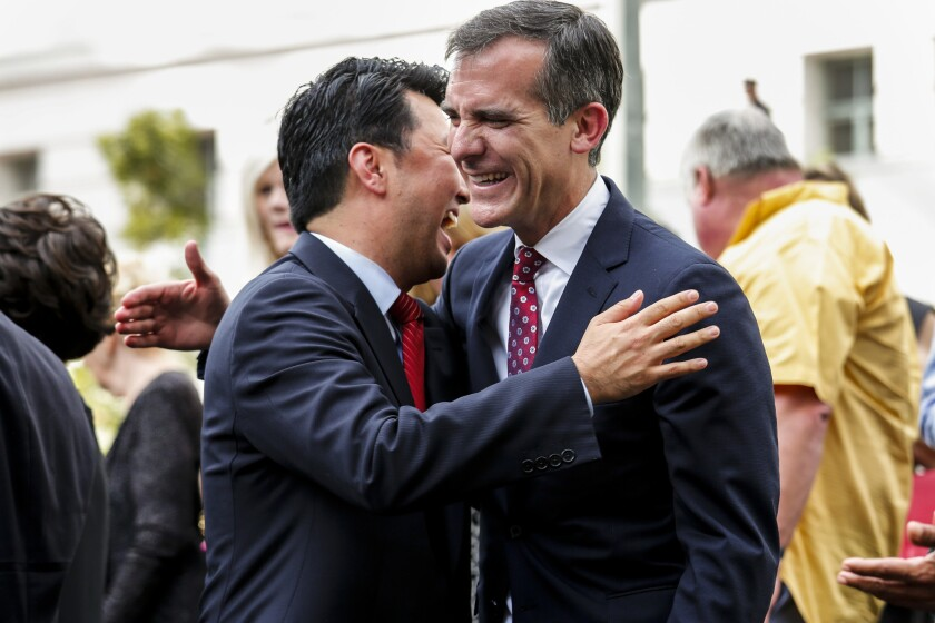 David Ryu hugs Los Angeles Mayor Eric Garcetti after he is sworn in as a city councilman on the steps of City Hall in 2015.