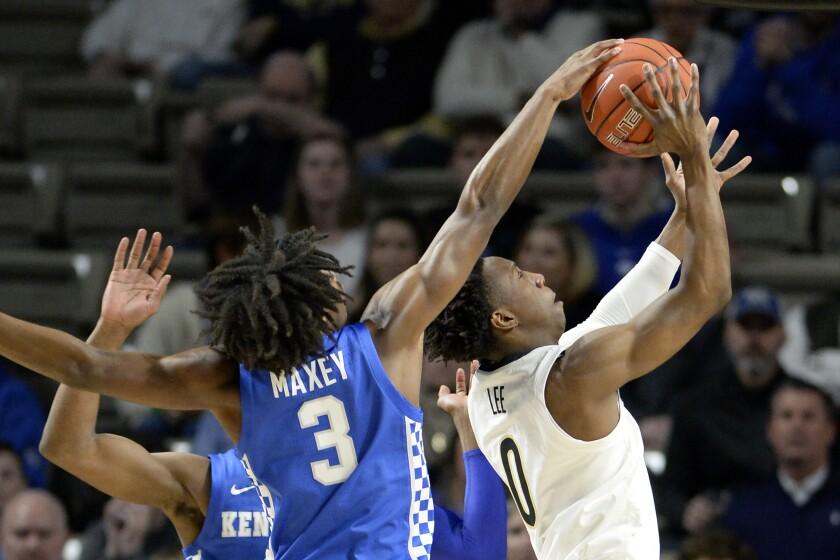 Kentucky guard Tyrese Maxey (3) blocks Vanderbilt guard Saben Lee's (0) shot from behind during the first half of an NCAA college basketball game Tuesday, Feb. 11, 2020, in Nashville, Tenn. (AP Photo/Mark Zaleski)