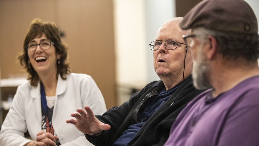 Tom Wright, center, participates in a Parkinson's disease therapy session at Los Alamitos Medical Ce
