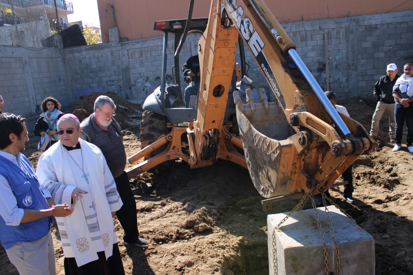Diego Morales from the UNHCR Head Office, Archbishop Francisco Moreno Barrón and Pat Murphy, director of the Casa del Migrante at the groundbreaking ceremony of the Scalabrini Migrant Training Center on Wednesday, January 22, 2020.