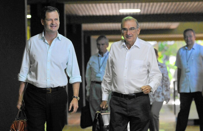 The head of the Colombian government delegation for peace talks with the FARC rebel group, Humberto de la Calle, right, and High Commissioner for Peace Sergio Jaramillo arrive for a new cycle of negotiations at the Conventions Palace in Havana.