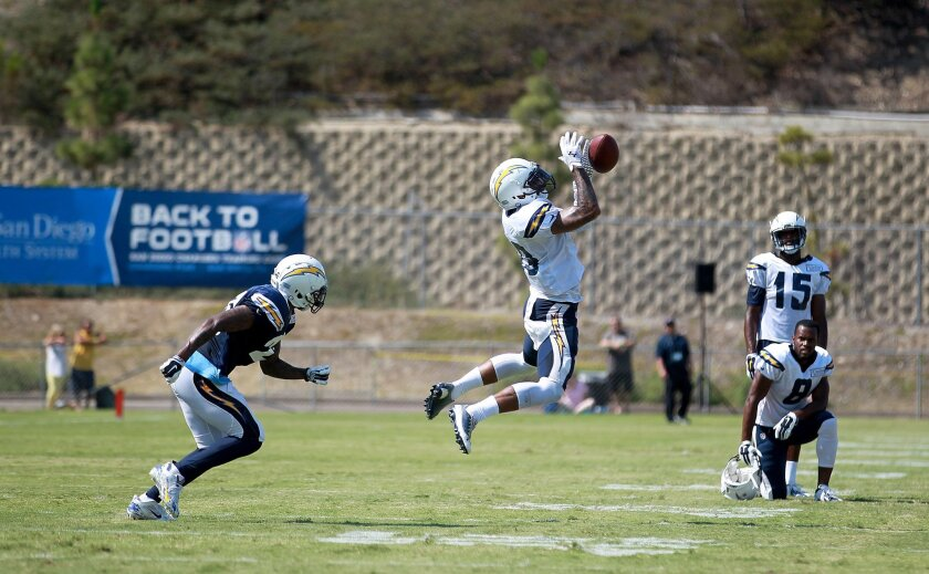 Chargers WR Keenan Allen worked a catch, right, while being covered by newly acquired Brandon Flowers, left.  John Gastaldo/U-T San Diego/Zuma Press