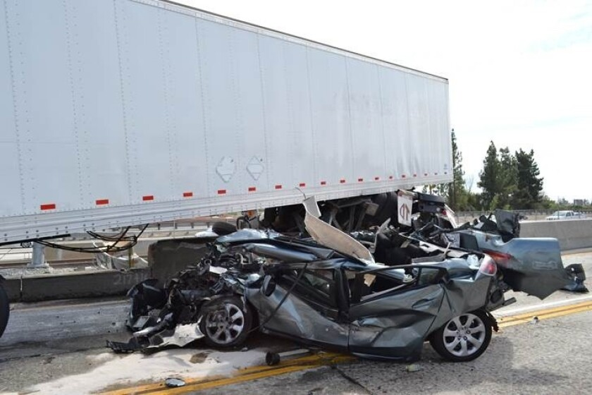 A car was crushed by a big rig on the 210 Freeway. Three people were hurt in the crash and are expected to survive.