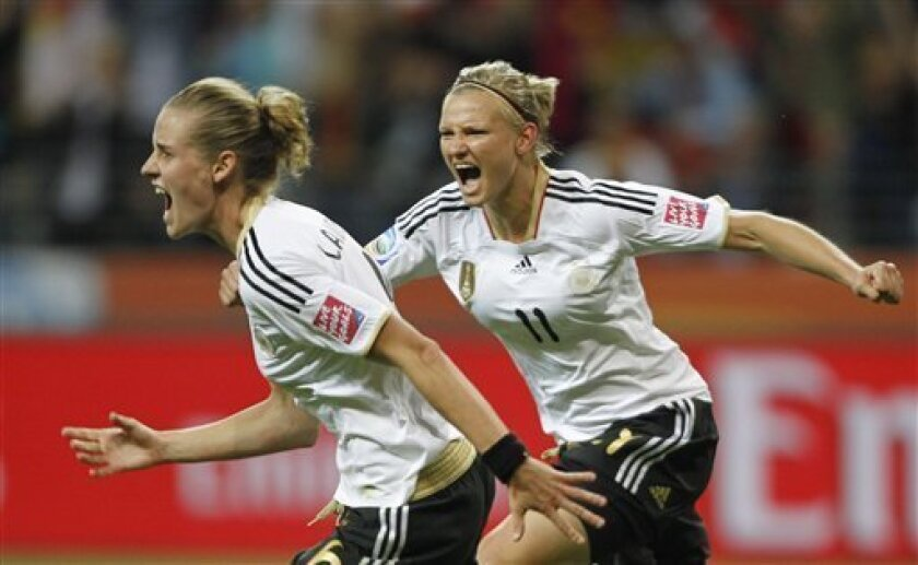 Germany's Simone Laudehr is congratuled by Germany's Alexandra Popp as she celebrates scoring the opening goal during the group A match between Germany and Nigeria at the Women's Soccer World Cup in Frankfurt, Germany, Thursday, June 30, 2011. (AP Photo/Matthias Schrader)