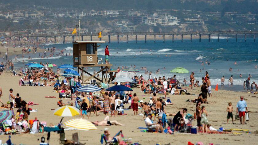 Schaben, Allen J. –– B58549992Z.1 NEWPORT BEACH, CA – JULY 2, 2010: A Newport Beach lifeguard keeps