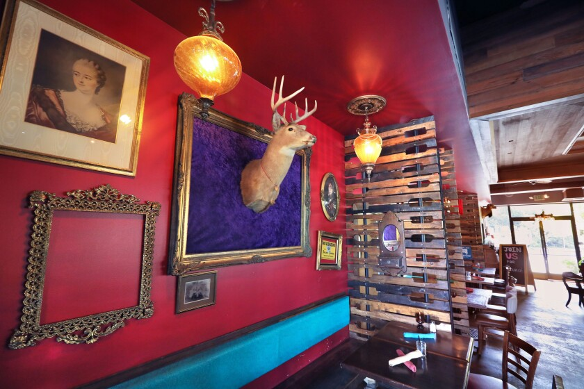 Interior view of part of the dining room of the Flying Pig Pub & Kitchen on S. Santa Ave. in downtown Vista.
