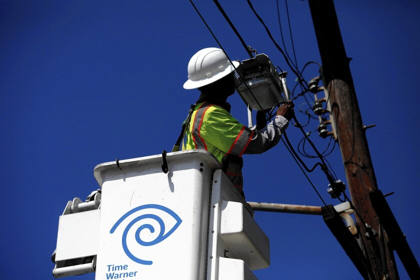 In recent weeks, Time Warner Cable and AT&T Inc. have said they are capable of delivering lightning-fast Internet speeds in L.A. and other big, lucrative markets. Above, a TWC technician in Manhattan Beach last year.
