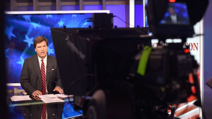 Making the case for white privilege: Tucker Carlson on the set of his Fox News program.