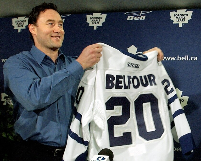 FILE - In this July 3, 2002, new Maple Leafs goaltender Ed Belfour receives his number 20 jersey at a news conference in Toronto. Ed Belfour is preparing to give up his Olympic gold medal for an opportunity to go into business with his son. The medal the Hockey Hall of Fame goalie won representing