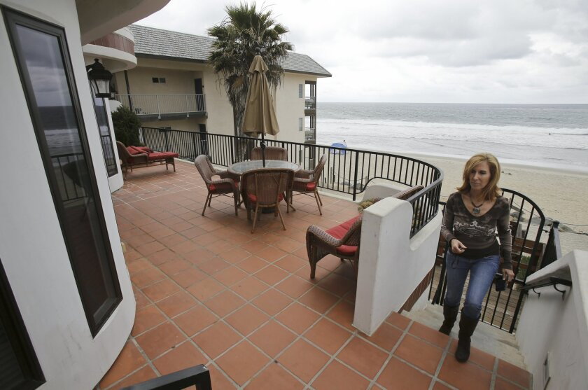 Vacation rental assistant manager Michele Barnes checks on one of the Carlsbad rental properties  managed by Barbara McLain Properties along Ocean Street on Thursday. New rules take effect June 4 for short-term vacation rentals in Carlsbad. Photo by Don Boomer