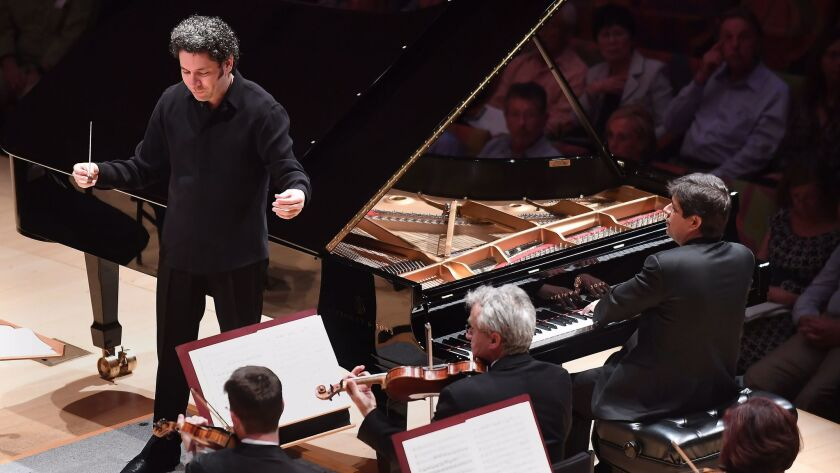 LOS ANGELES, CA-OCTOBER 1, 2012: Pianist Javier Perianes, right, performs with conductor Gustavo Dud