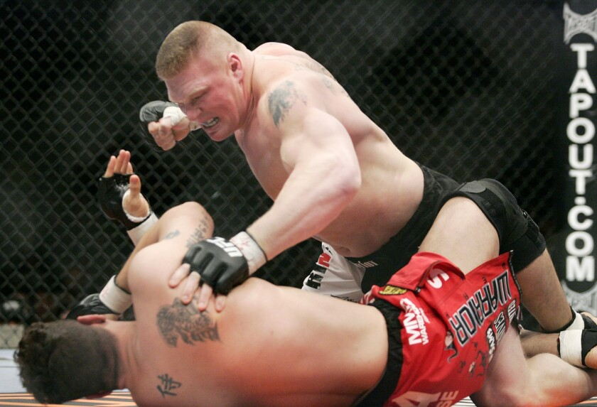 Brock Lesnar, top, fights Frank Mir during the first round of a UFC heavyweight bout in February 2008.