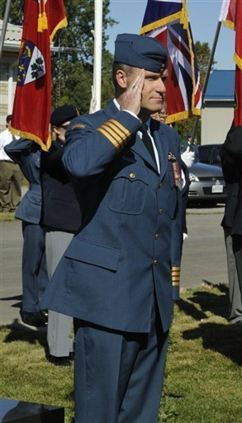 FILE - In this Sept. 20, 2009 file photo provided by the Dept. of National Defense via The Canadian Press, Col. Russell Williams salutes as he arrives at the Battle of Britain parade in Trenton, Ontario. Michael Edelson, Williams' lawyer, told a judge on Thursday, Oct. 7, 2010 that Williams intends to plead guilty to murder, sexual assaults and dozens of breaking and entering charges at his next court appearance on Oct. 18. (AP Photo/Dept. of National Defense via The Canadian Press)