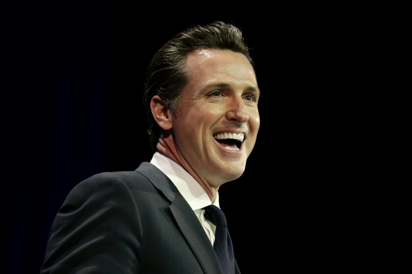 FILE - In this Saturday, March 8, 2014 file photo, California Lt. Gov. Gavin Newsom smiles while speaking at the California Democrats State Convention in Los Angeles.  Newsom says he will begin raising money to run for California governor in 2018. In a written announcement Wednesday, Feb. 11, 2015,
