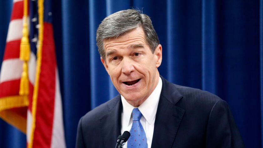 North Carolina Gov.-elect Roy Cooper speaks at a press conference Dec. 15.