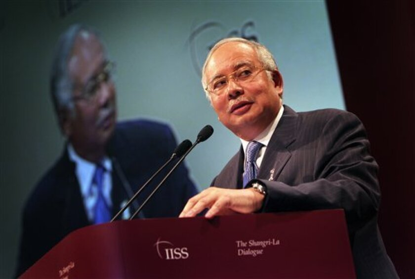 Malaysia's Prime Minister Najib Razak delivers his keynote address at the opening session of the IISS Shangri-la Security Summit on Friday June 3, 2011 in Singapore.(AP Photo/Wong Maye-E)