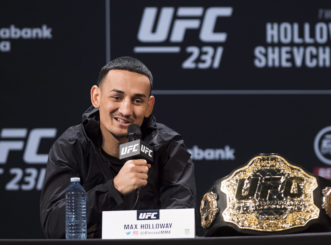 UFC featherweight champion Max Holloway speaks at a press conference, Wednesday, Dec. 5, 2018 in Toronto. UFC 231 takes place on Saturday, Dec. 8, 2018. (Nathan Denette/The Canadian Press via AP)