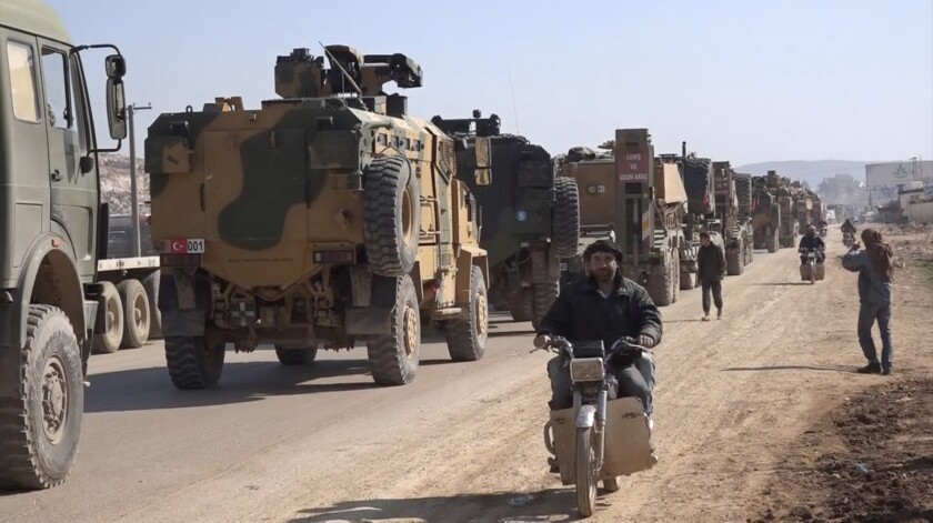 An image taken from video shows a Turkish military convoy in the northwestern province of Idlib, Syria, on Sunday.