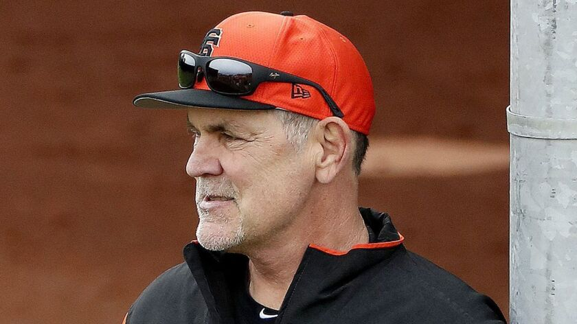 FILE - In this Feb. 13, 2019, file photo, San Francisco Giants manager Bruce Bochy watches his team