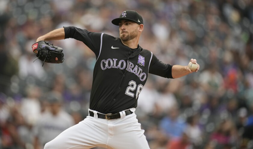 Colorado Rockies starting pitcher Austin Gomber works against the Miami Marlins during the first inning of a baseball game Saturday, Aug. 7, 2021, in Denver. (AP Photo/David Zalubowski)