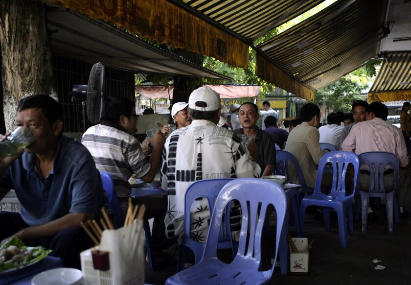 Vietnamese men drink beer at an outdoor beer parlor in Hanoi, Vietnam on Wednesday Oct. 8, 2014. A ministry official is proposing that the temperature in restaurants selling beer in Vietnam should not exceed 30 degrees Celsius (86 Fahrenheit), a rule that will be hard to enforce considering outdoor beer parlors are hugely popular in the country's big cities. (AP Photo/Tran Van Minh)