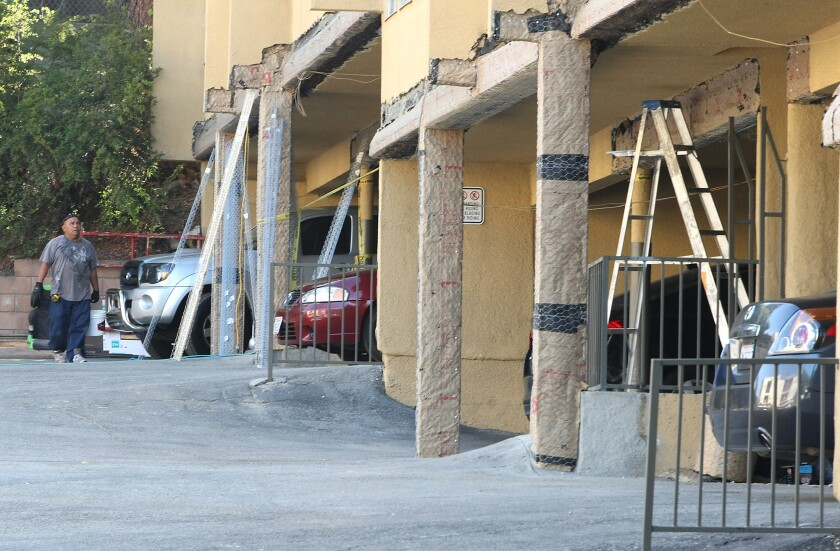 Construction workers seismically retrofit Montrose apartment building