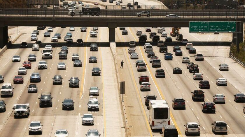 Traffic makes its way through the Sepulveda Pass on the 405 Freeway on Aug. 2.
