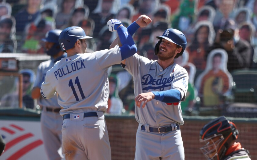 Dodgers' A.J. Pollock is congratulated by Cody Bellinger.