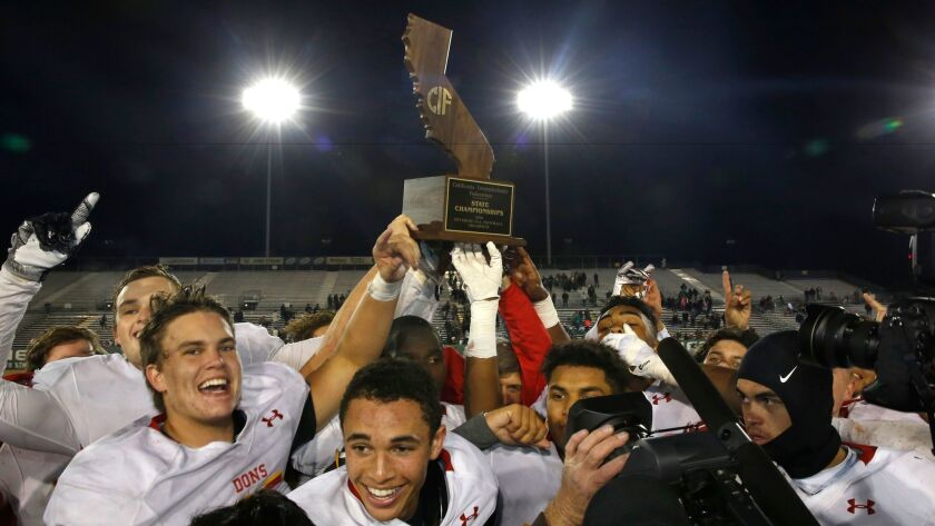 Cathedral Catholic players savor their Division 1-AA state title after Friday's overtime victory over Stockton St. Mary's.