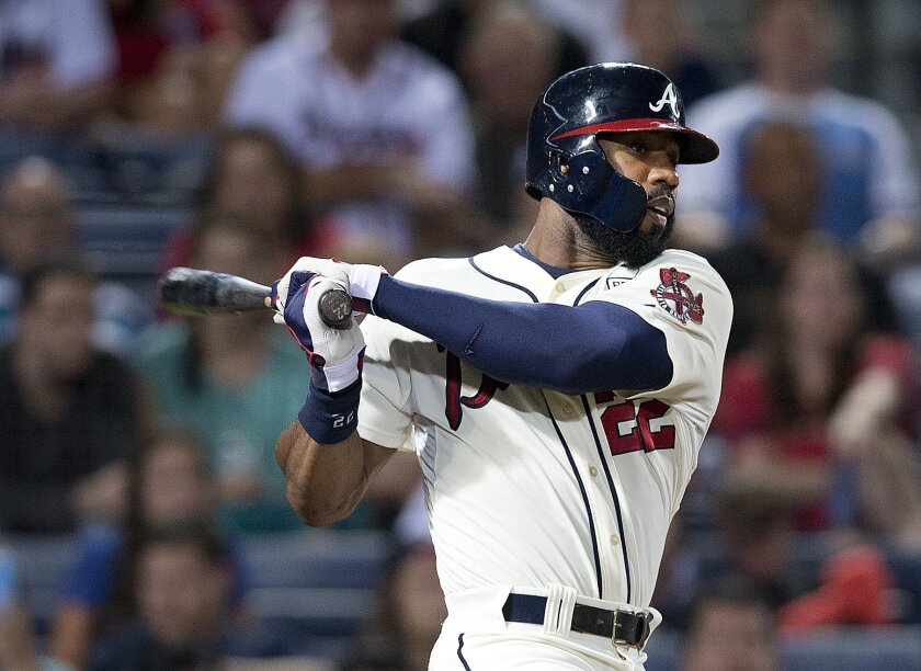 Atlanta Braves right fielder Jason Heyward (22) drives in a run with a base hit in the fourth inning of a baseball game against the Washington Nationals Sunday, Aug. 10, 2014 in Atlanta. (AP Photo/John Bazemore)