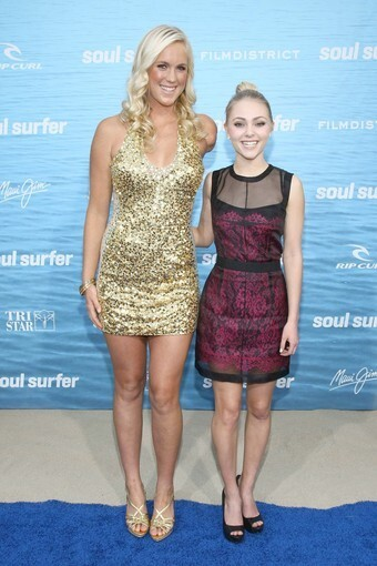 """Bethany Hamilton, left, and her onscreen counterpart, AnnaSophia Robb, met up on the red carpet Wednesday night to celebrate the opening of their new biopic, """"Soul Surfer."""" The movie tells the story of Hamilton's shark attack when she was 13 and how she bounced back from the tragedy and continued surfing, despite losing an arm."""