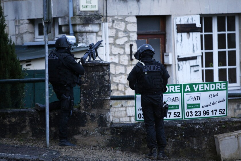 Police patrol during Friday's manhunt for the suspects in the shooting attack at a French newspaper this week.