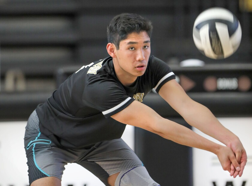 Westview's Adam Chang warms up before match in his senior season in 2019.