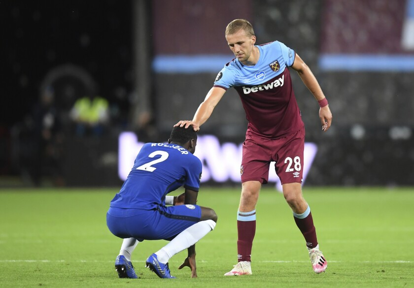 West Ham's Tomas Soucek, right puts his hand on Chelsea's Antonio Rudiger's head after the end of the English Premier League soccer match between West Ham United and Chelsea at the London Stadium stadium in London, Wednesday July 1, 2020. West Ham won the game 3-2. (Michael Regan/Pool via AP)