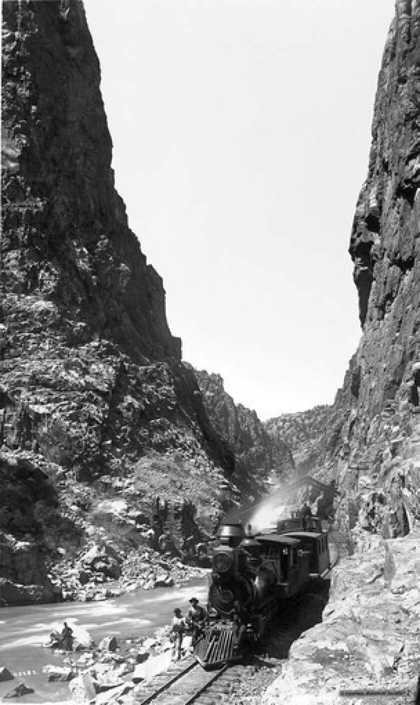 Downstream from the Hanging Bridge, Denver and Rio Grande Engine No. 206 pauses for the requisite photo; the locomotive with caboose suggests this may have been an excursion for photographer William Henry Jackson, who was frequently accorded special trains.