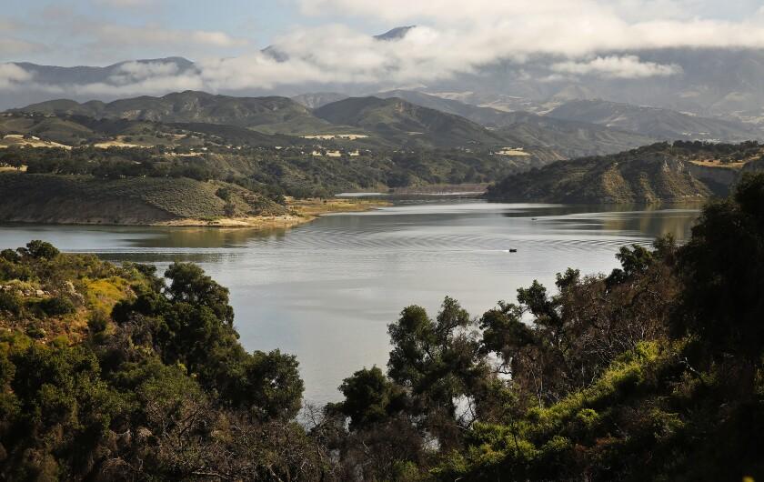 A boat glides across Cachuma Reservoir, north of Santa Barbara.